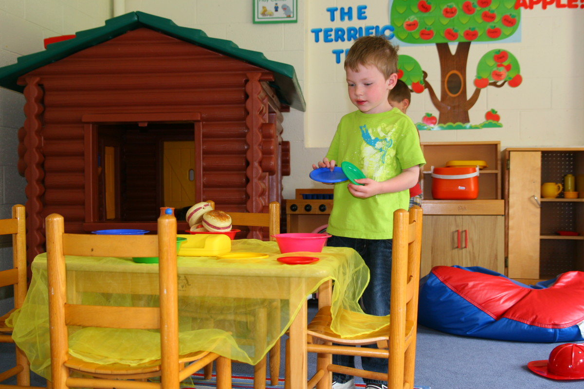 Pretending to cook and serve food with a play kitchen will increase a child's language skills.