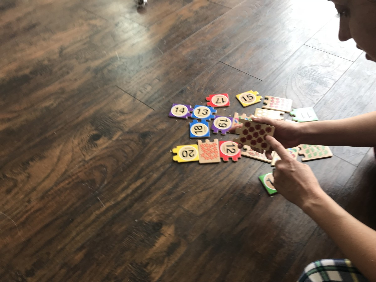 As I model counting larger quantities, Zoe likes to take a turn as photographer.