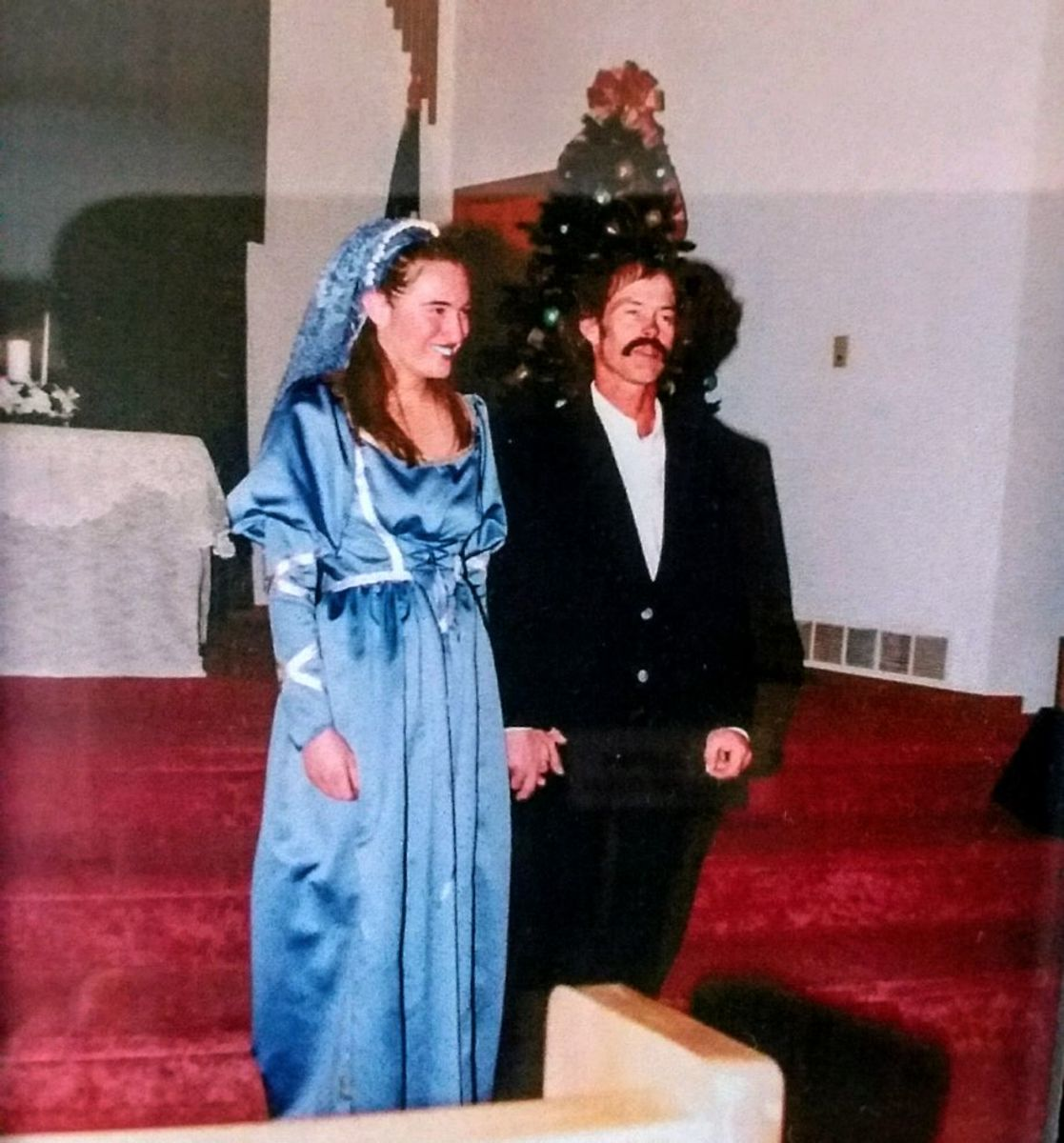 My mother and I made this gown, modifying a pattern we bought. It was an adventure, first designing the dress, finding the lavender blue satin, and stumbling across a pattern which was close to my ideal. But the memories are worth the trouble.