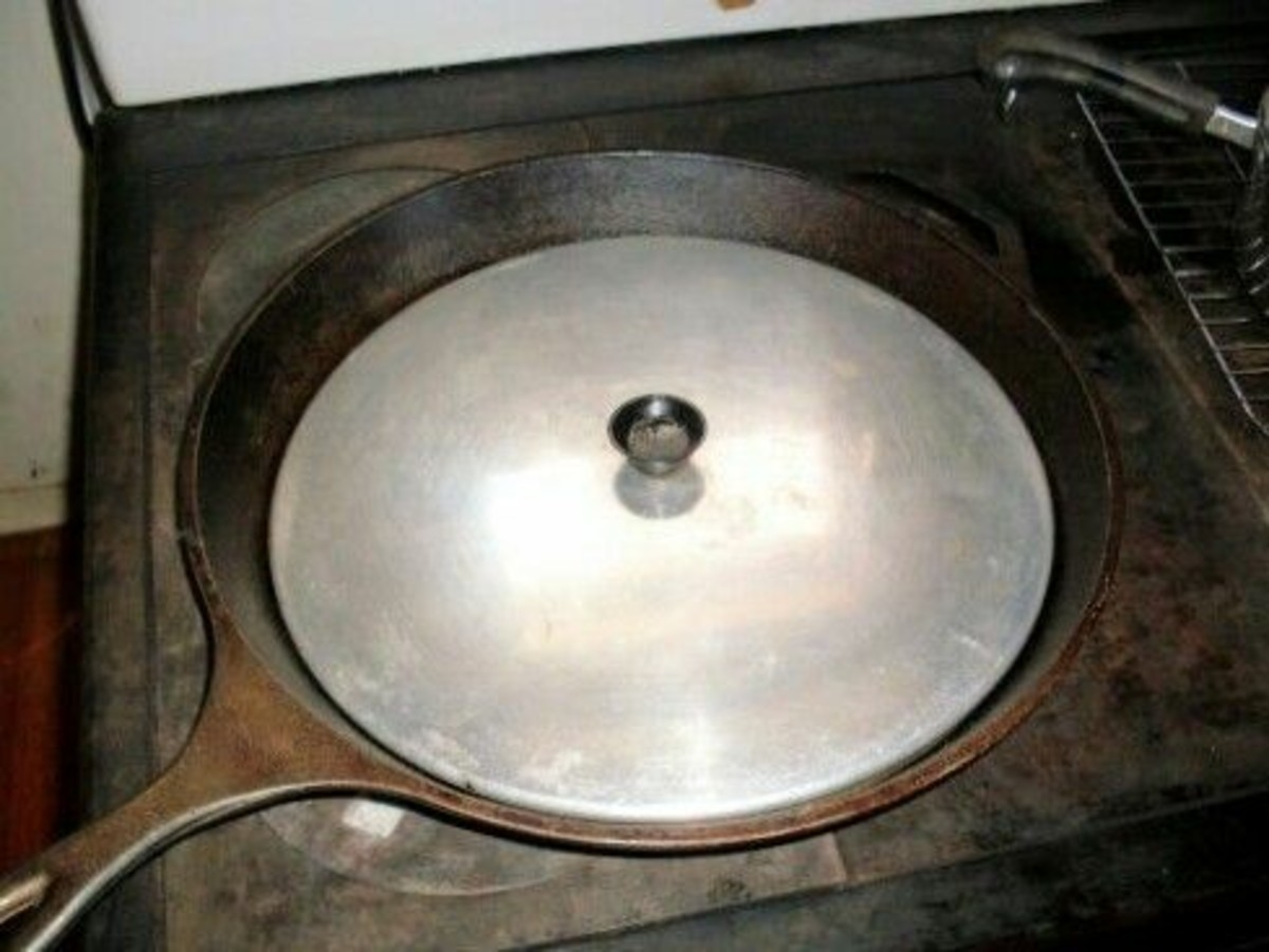 """This unusually large cast iron skillet, being 14"""" in diameter, is big enough to do stir-fry for a medium-size family, or cook several steaks at once."""