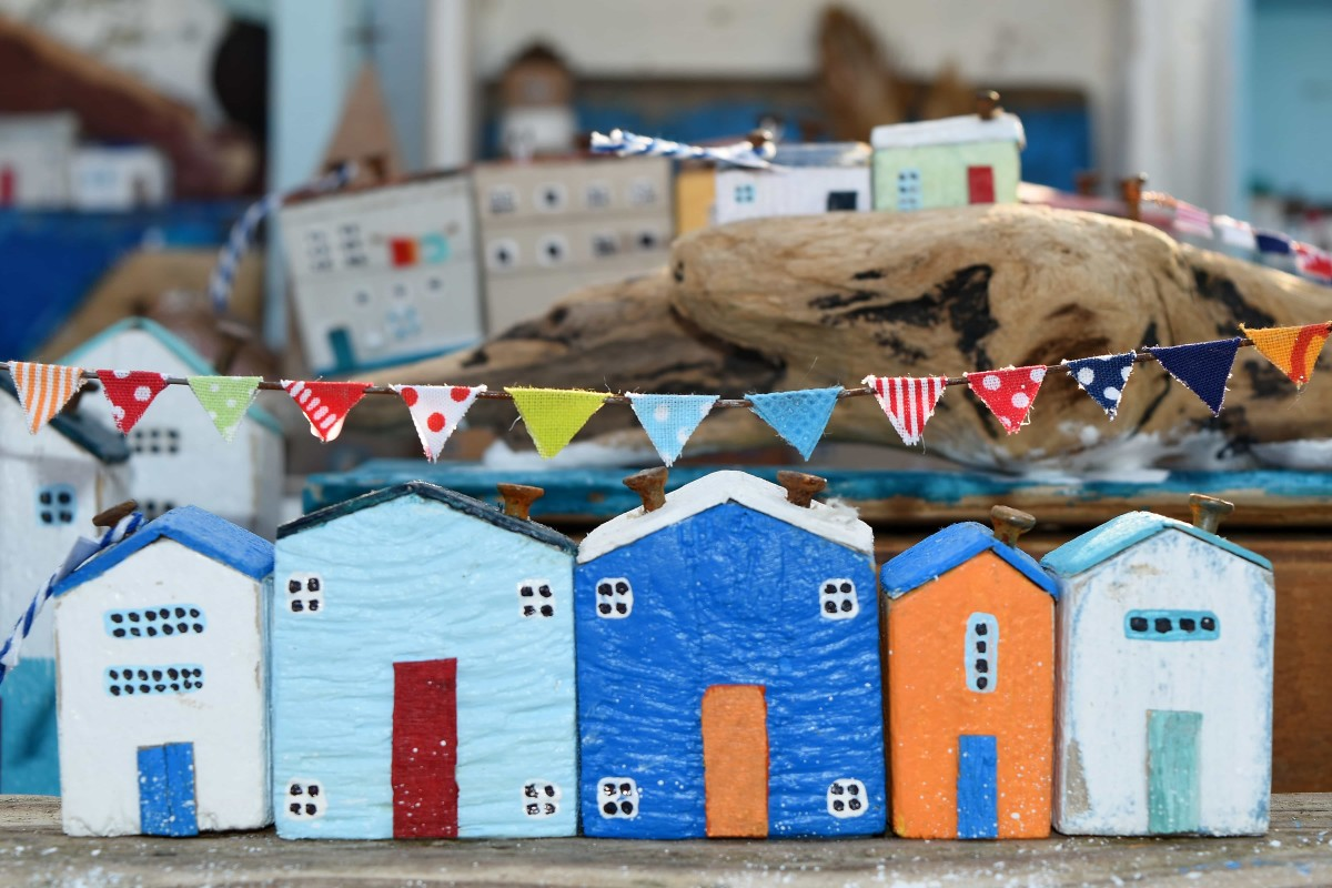 Children can use their imaginations and exercise problem-solving skills by figuring out how to construct a cardboard town.