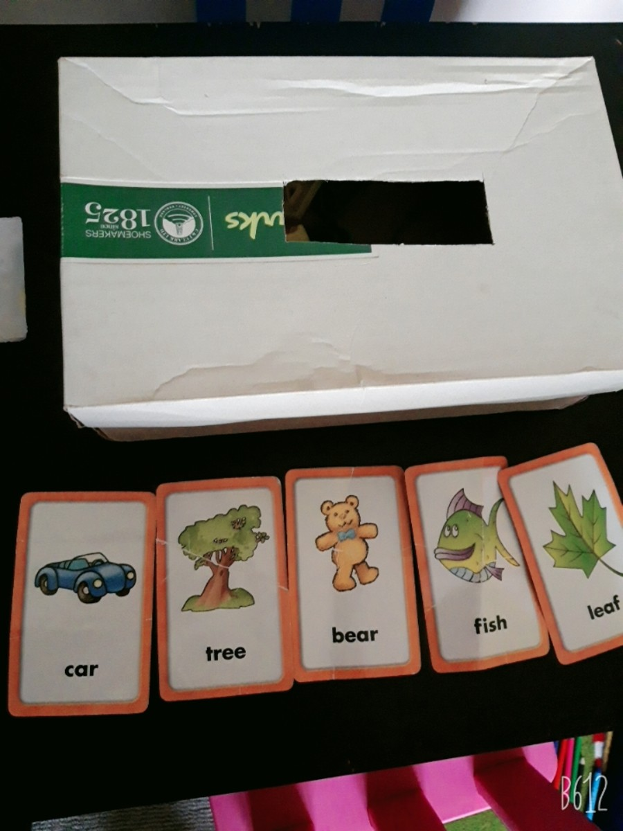You can use a shoebox and have your child drop in flashcards or other objects.