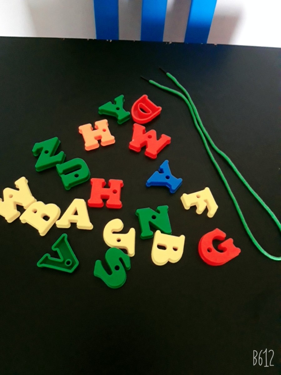 The supplies for the alphabet letter lacing game.