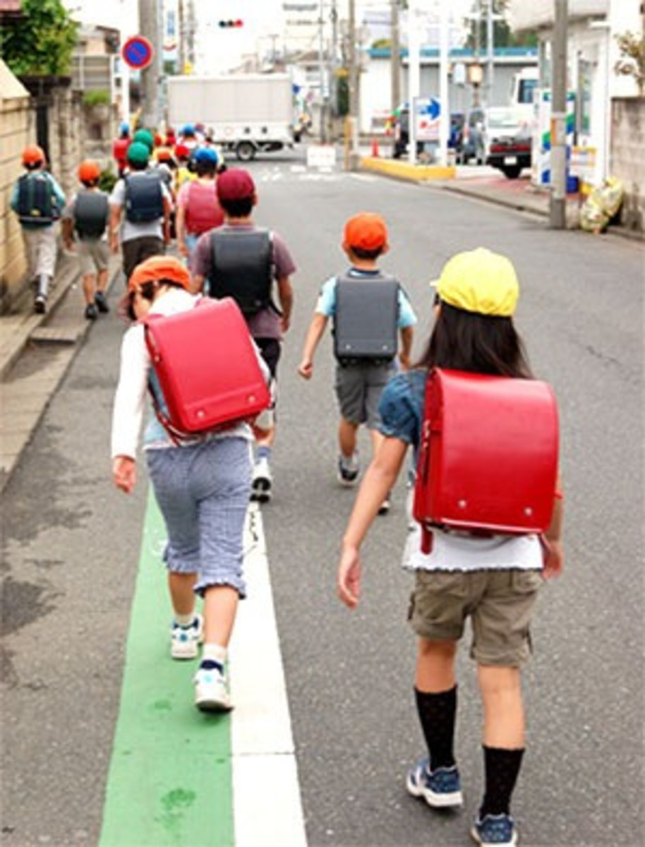 Children walking to school together (wearing randoseru).