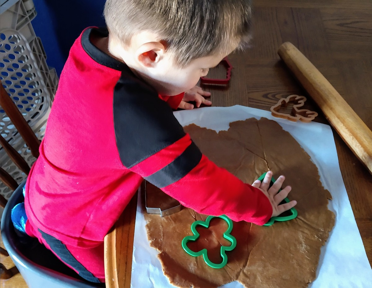 Making cookies with cookie cutters.