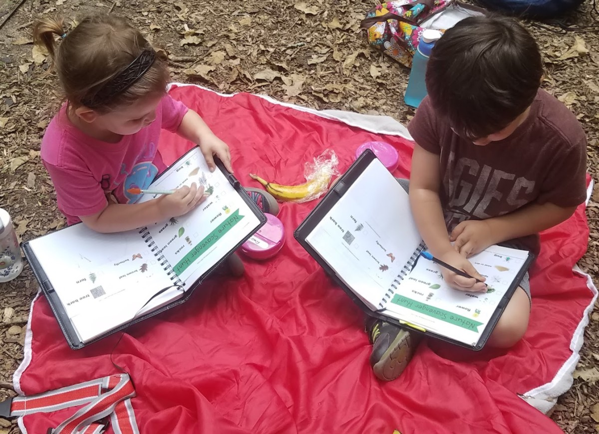 Here, the kids are marking off items they've found during a backyard scavenger hunt.