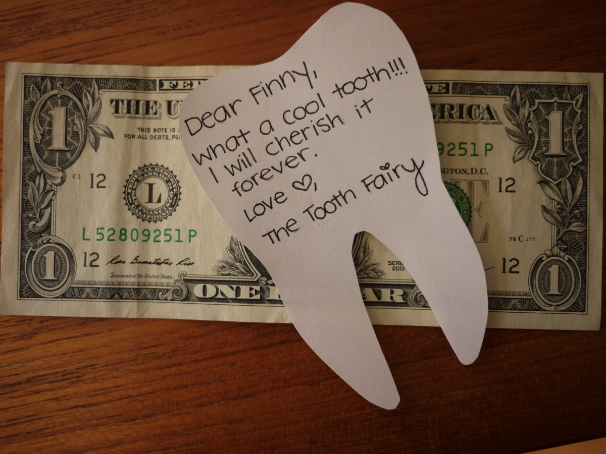 A tiny tooth-shaped note from the Tooth Fairy.