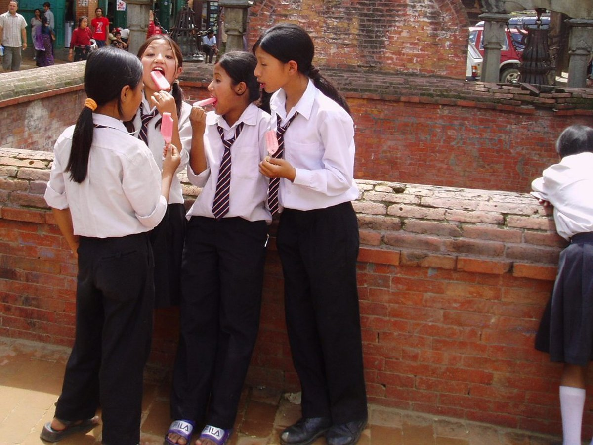 Schoolgirls in Nepal wear trousers.