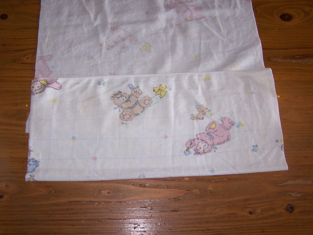 Fold fabric over liner centering over pins.