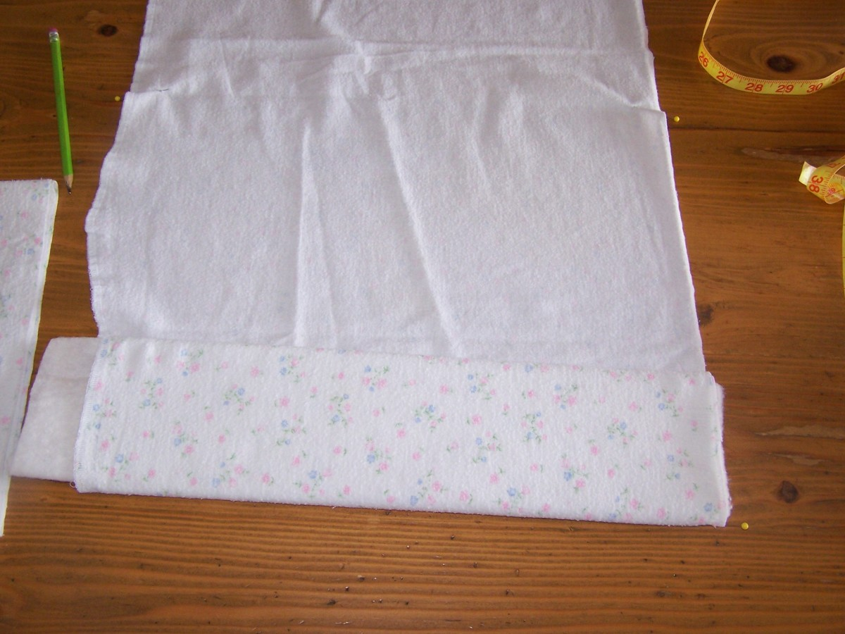 Roll extra fabric around liner to form an absorbent core.