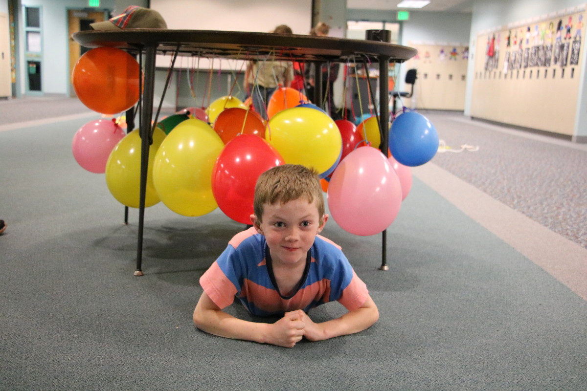 """Avoid the balloon """"meteorites"""" in a dinosaur themed obstacle course!"""