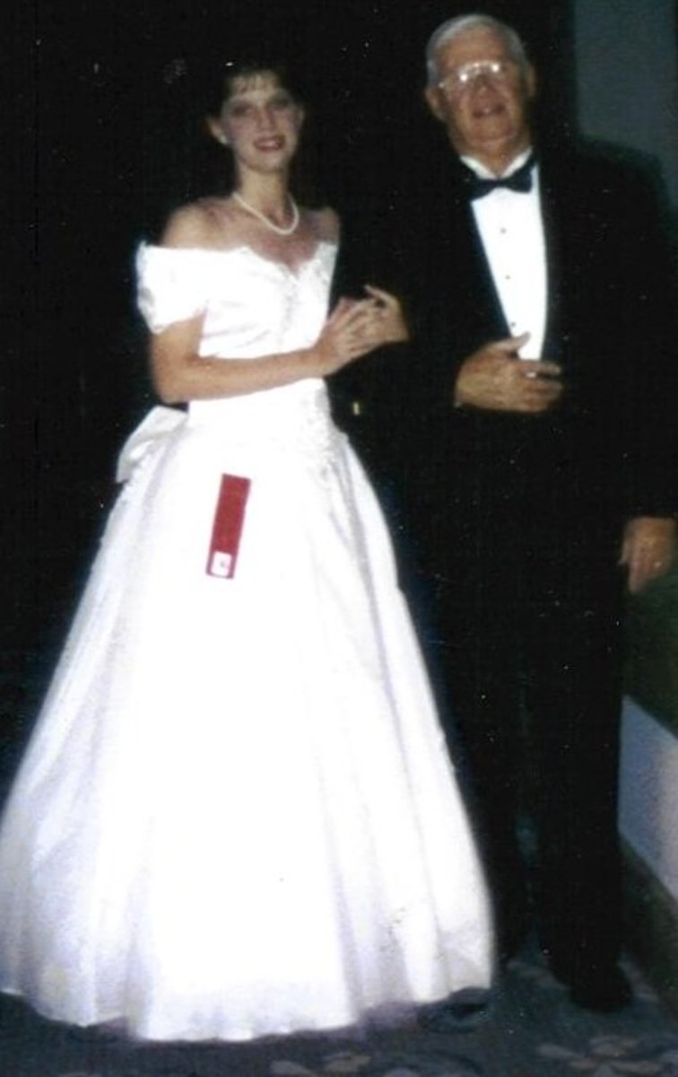 My father and I at the pageant my mother made me enter. I was in the top ten, and probably could have made it further, but my heart just wasn't in it.