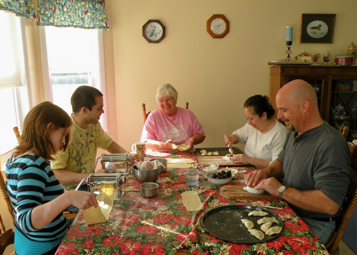 Passing on family traditions is one role of a grandmother. Here the whole family makes pirogies for Christmas Eve dinner.