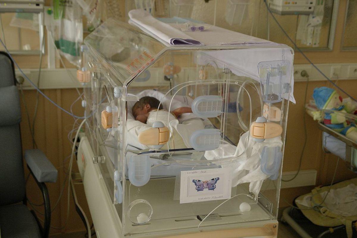 A premature baby in a NICU incubator.