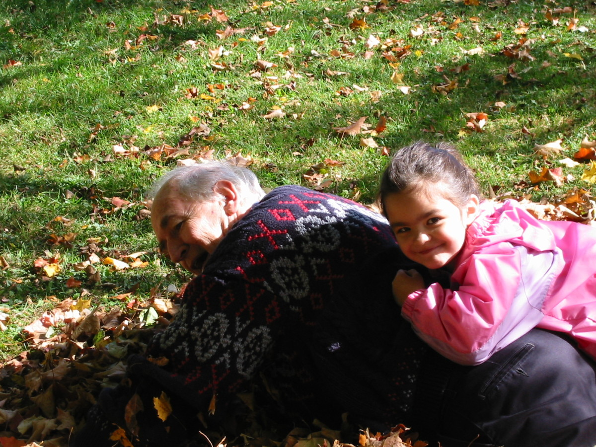 Playing in autumn leaves brings out the little kid in all of us.