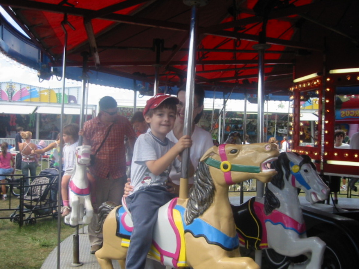 Having fun on the merry-go-round at the fall fair.