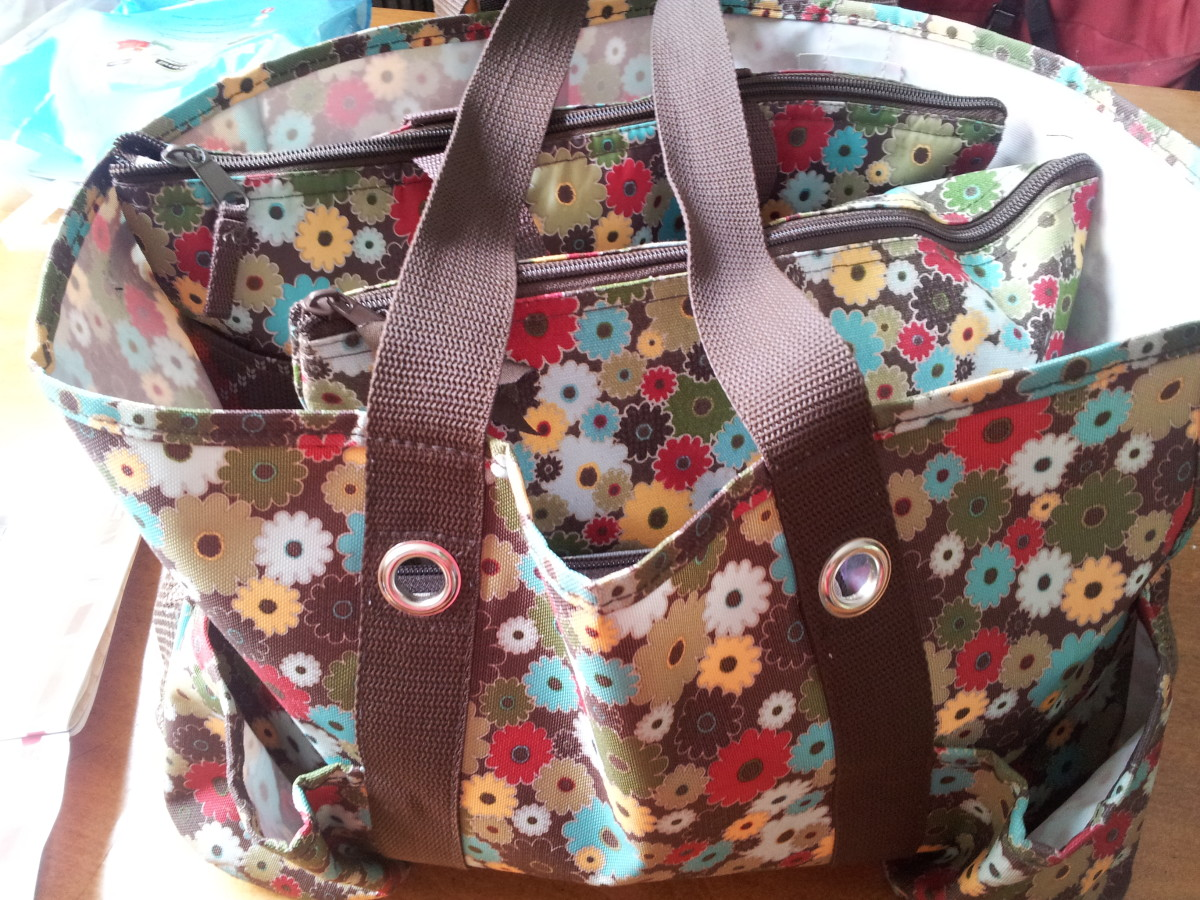 My favorite diaper bag is my Thirty One Organizing Utility Tote. I also have a zipper bag and cooler inside to keep things neat.