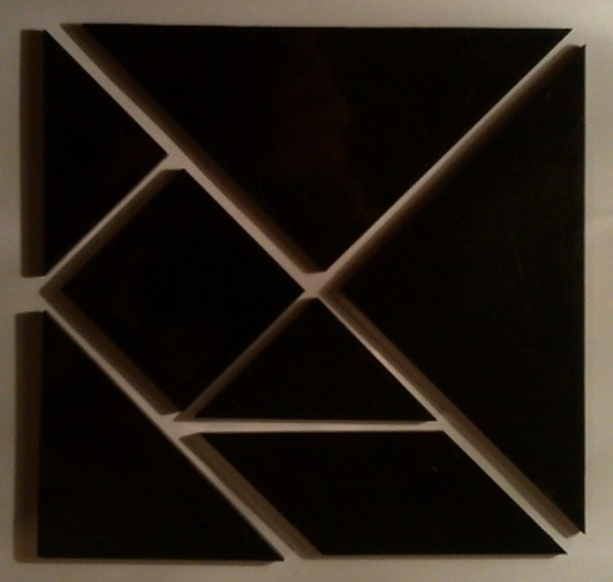 One way to put the tangram pieces together to make a square.
