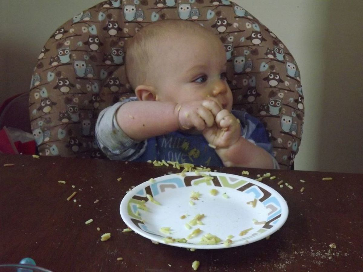 """My 8 month old's version of the sign """"more"""""""