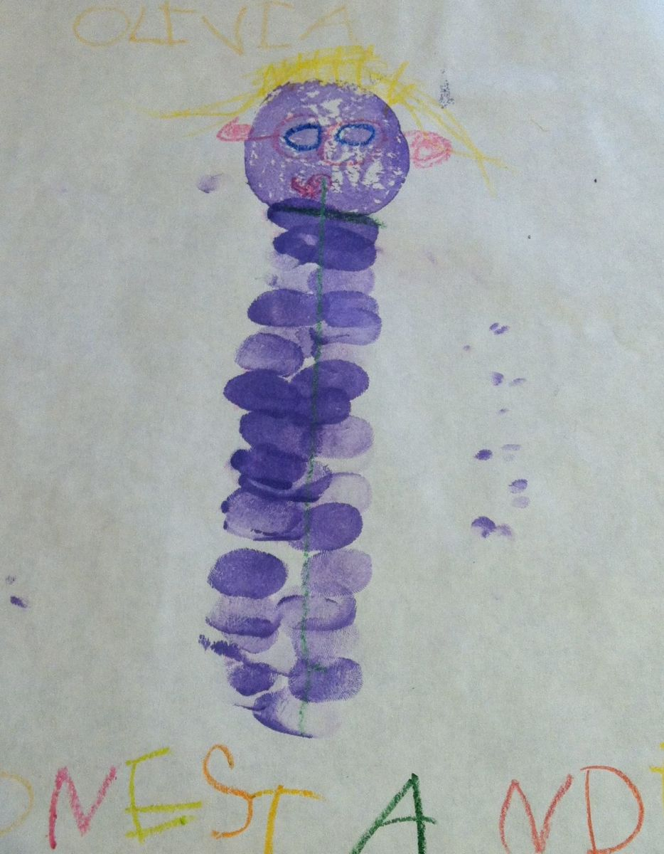 Potato print and fingerprints to create Lupe the Lupine.