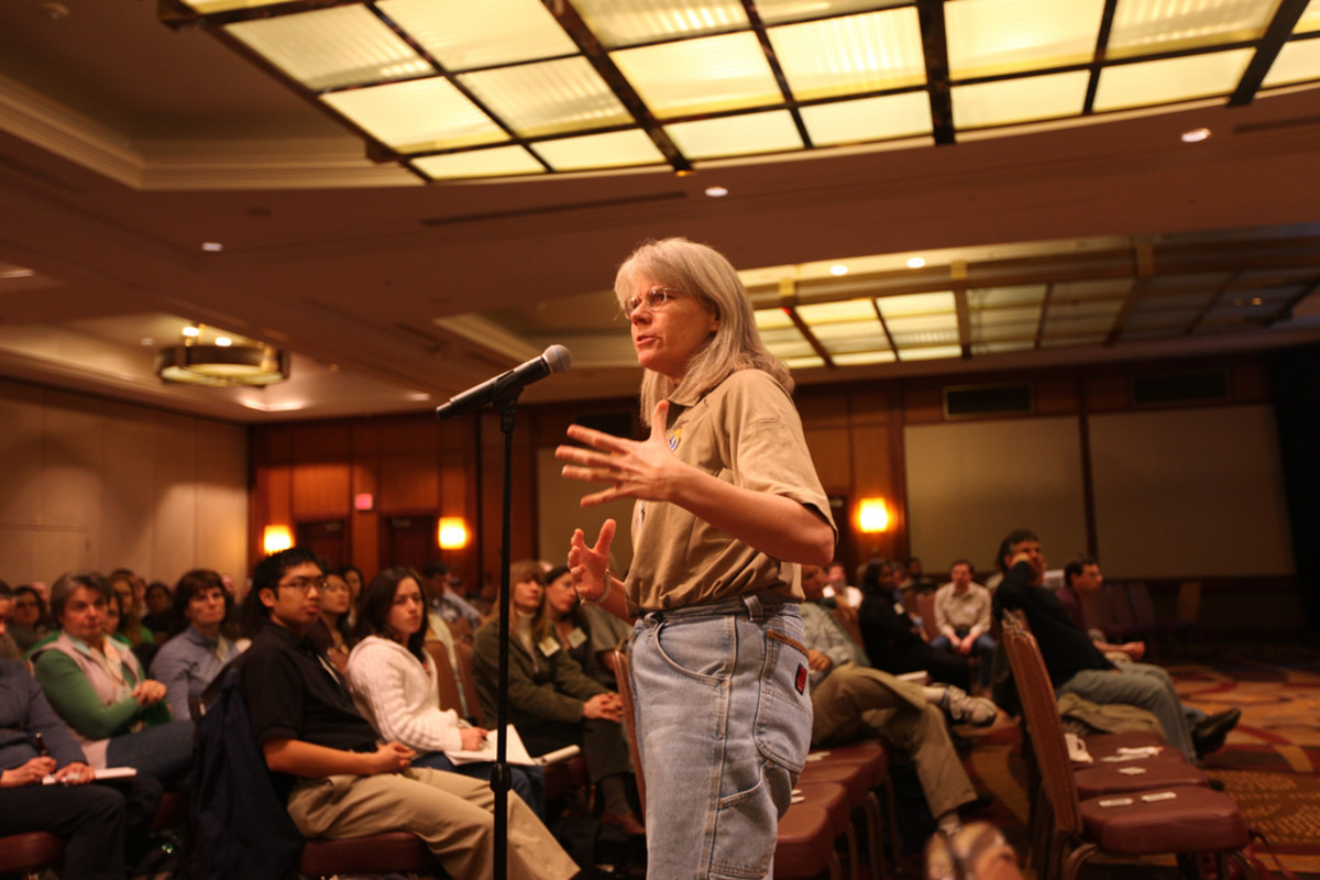This biologist is rockin' those mom jeans at a pubic town hall meeting where she's addressing the public.  Triple bonus points for not dressing up.  Love this gal!