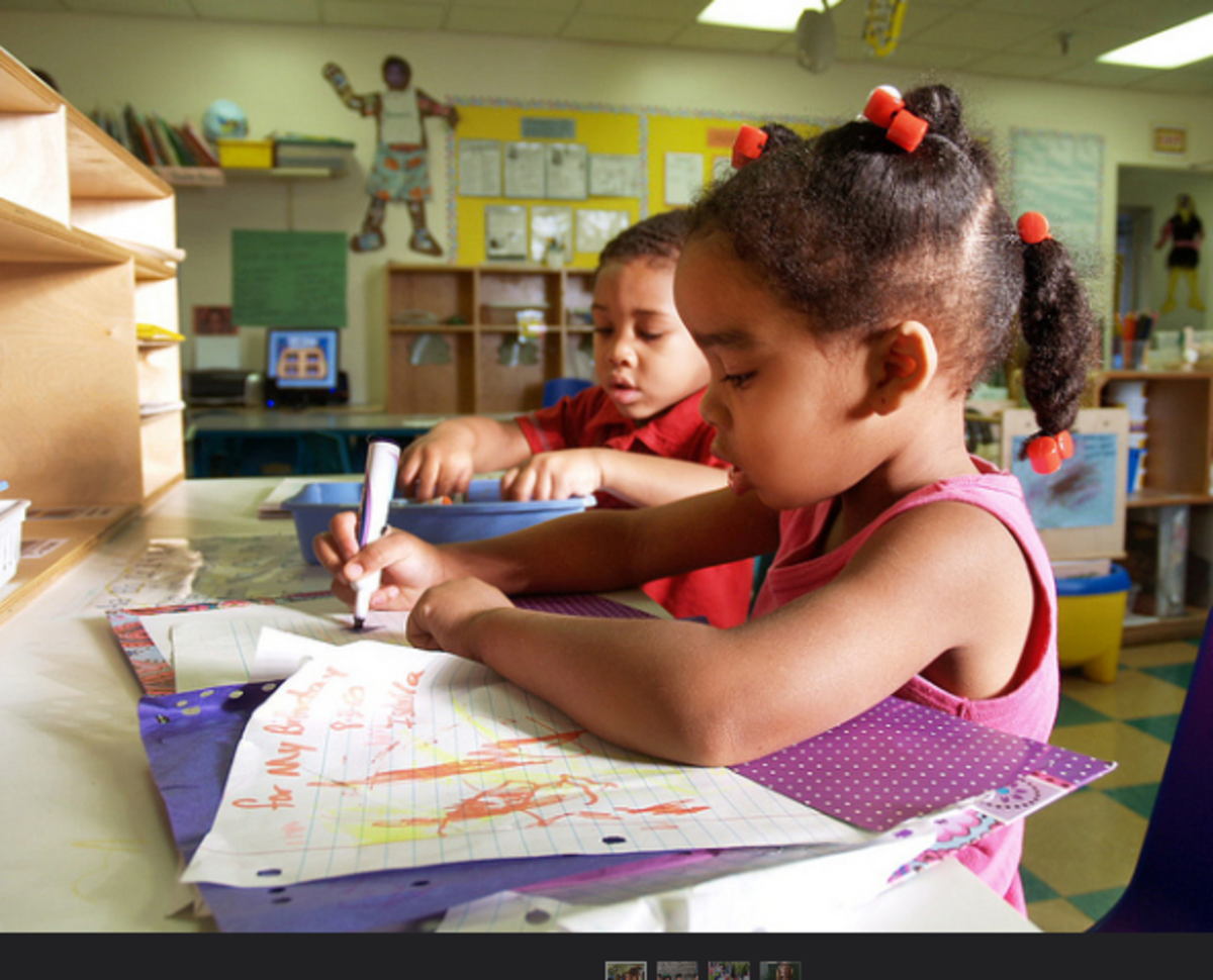 A writing center promotes meaningful writing: posters, signs, cards, letters, and lists.