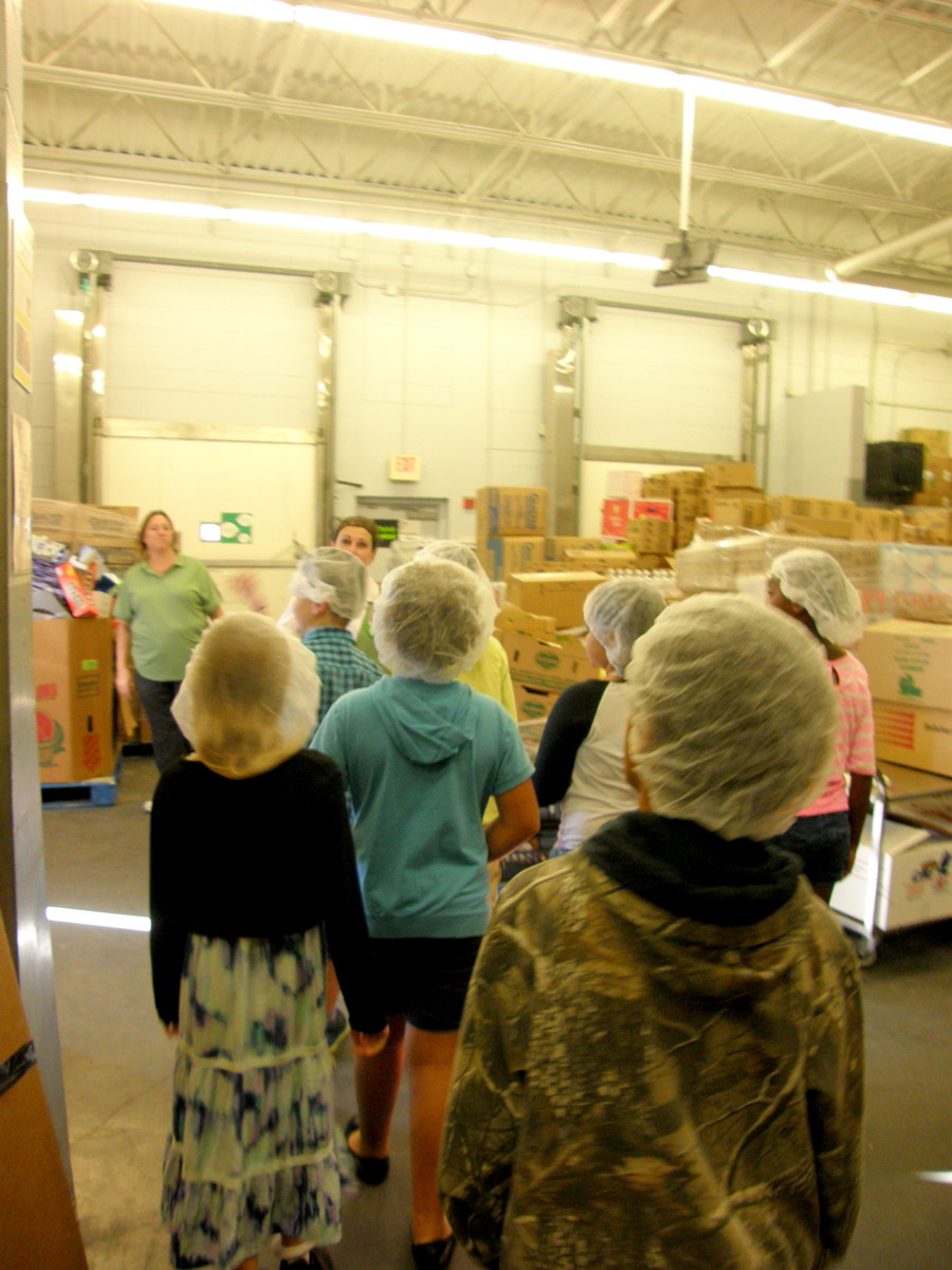 Students watched for a bit as a truck was loaded with food to take to one of the local food banks.
