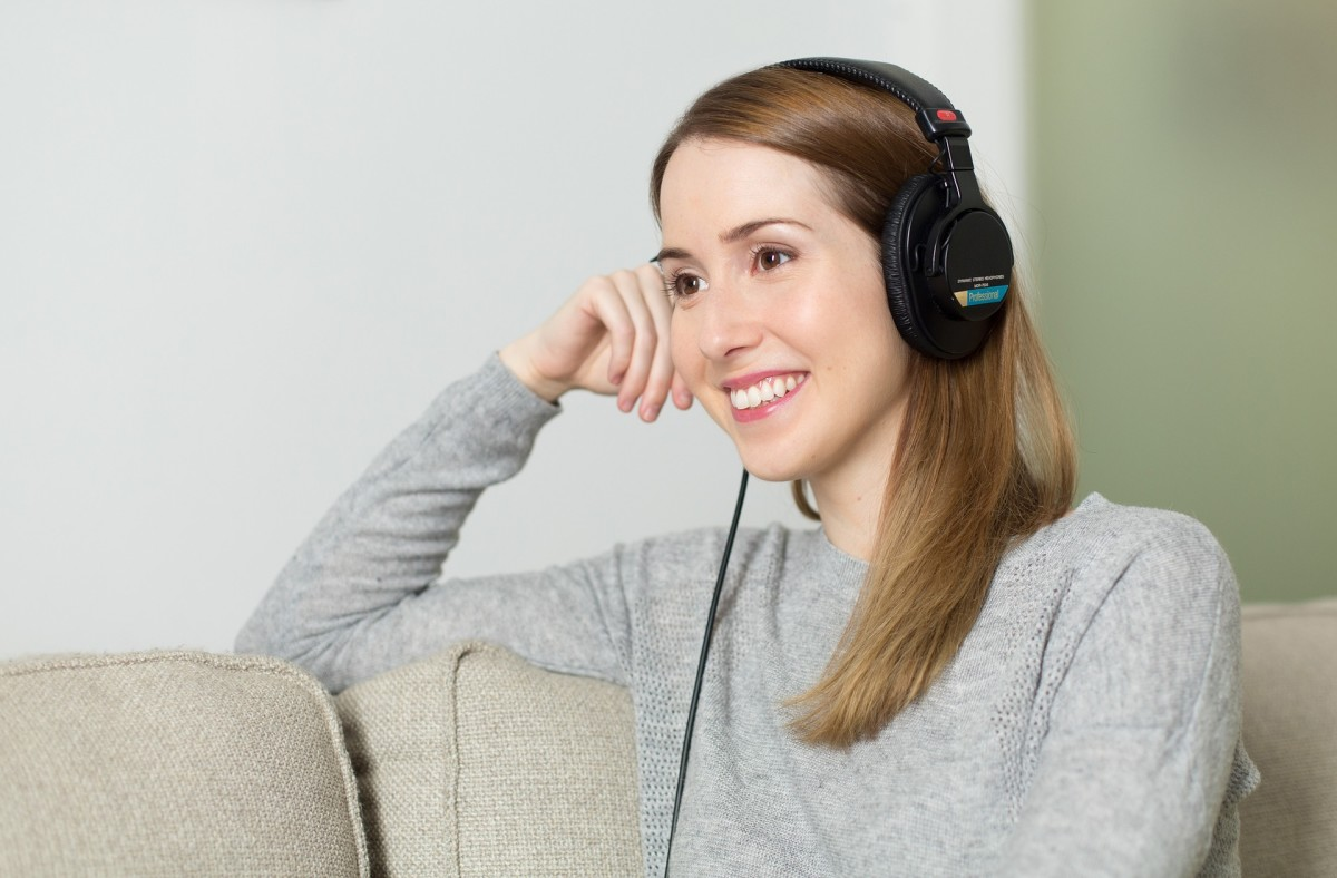 Putting on headphones and listening to your favorite audiobook is a great way to tune out the world for a while to focus on yourself.