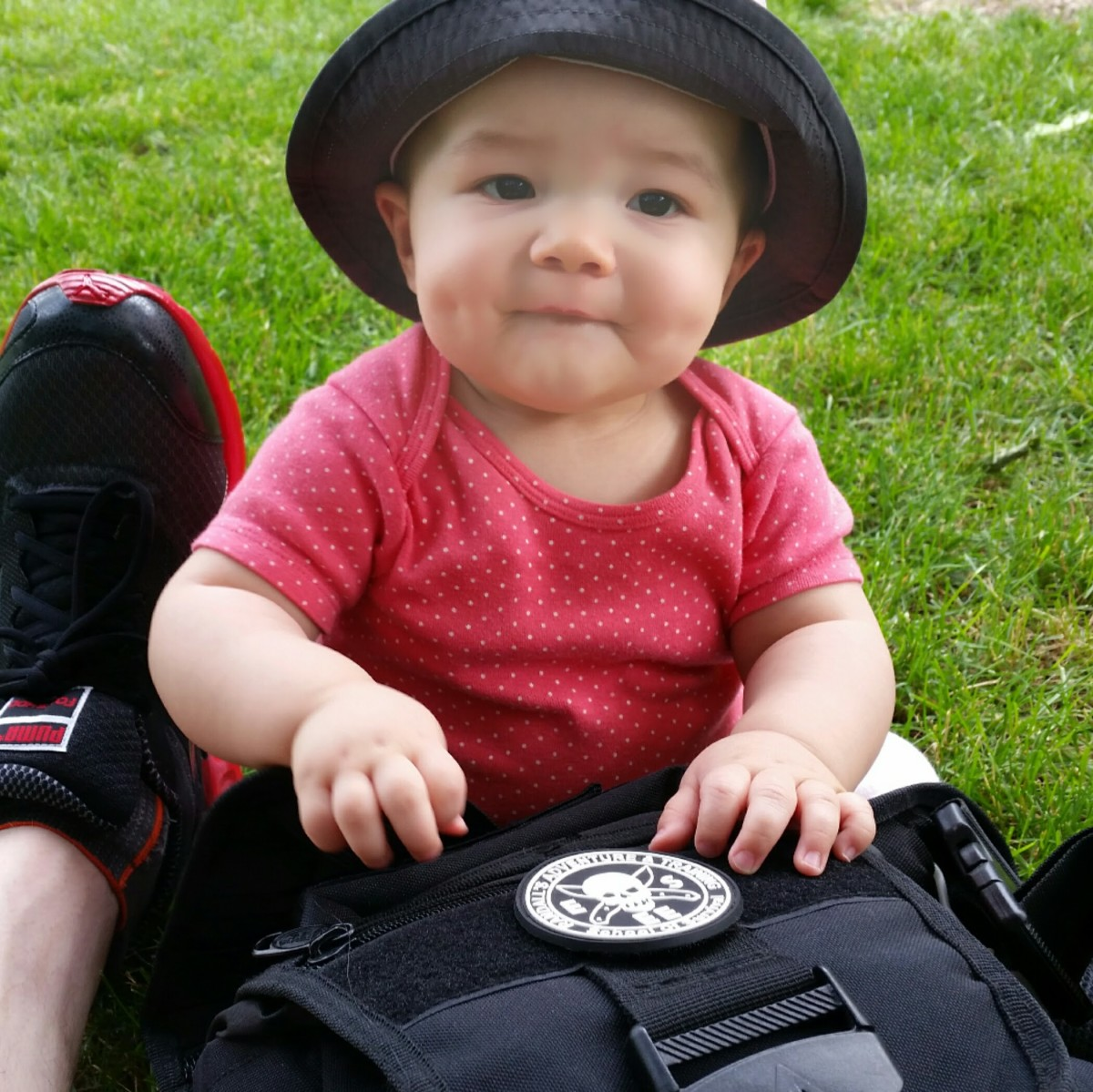 Adorable baby with tactical diaper bag.