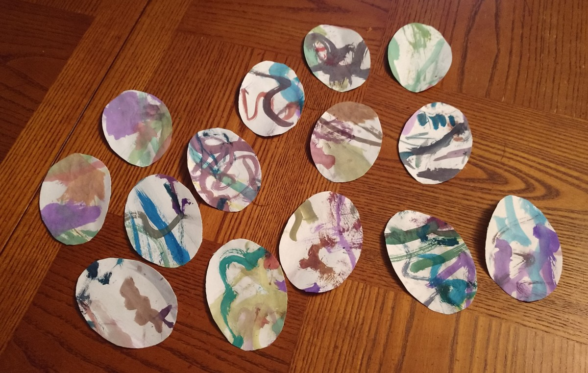 Rather than being saved in a pile or folder somewhere never to see the light of day, my two year old's water color painting, was cut into Easter eggs, and sent in Easter cards to the grandparents and great grandparents.