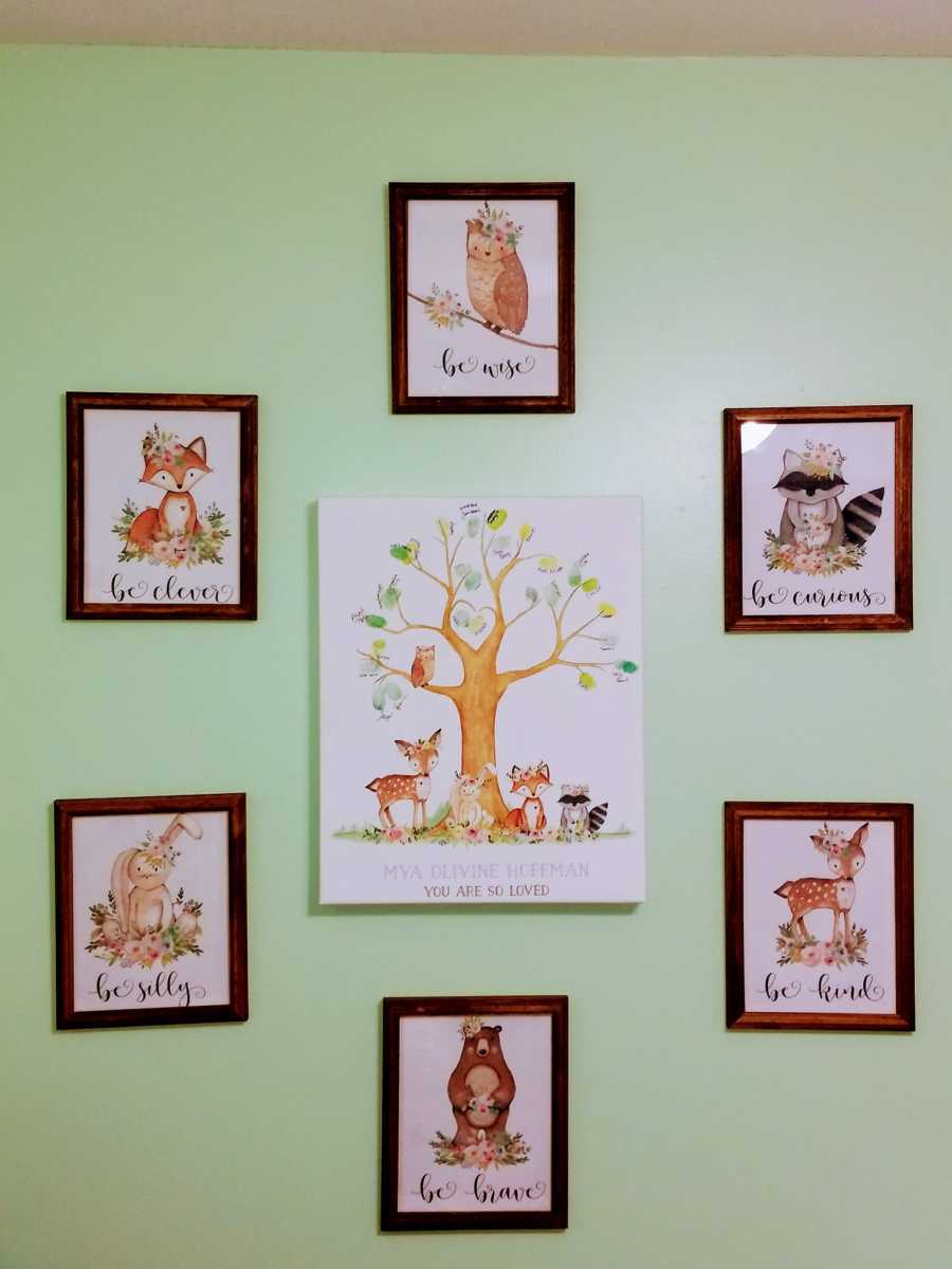 Tree guest book surrounded by framed woodland creature prints