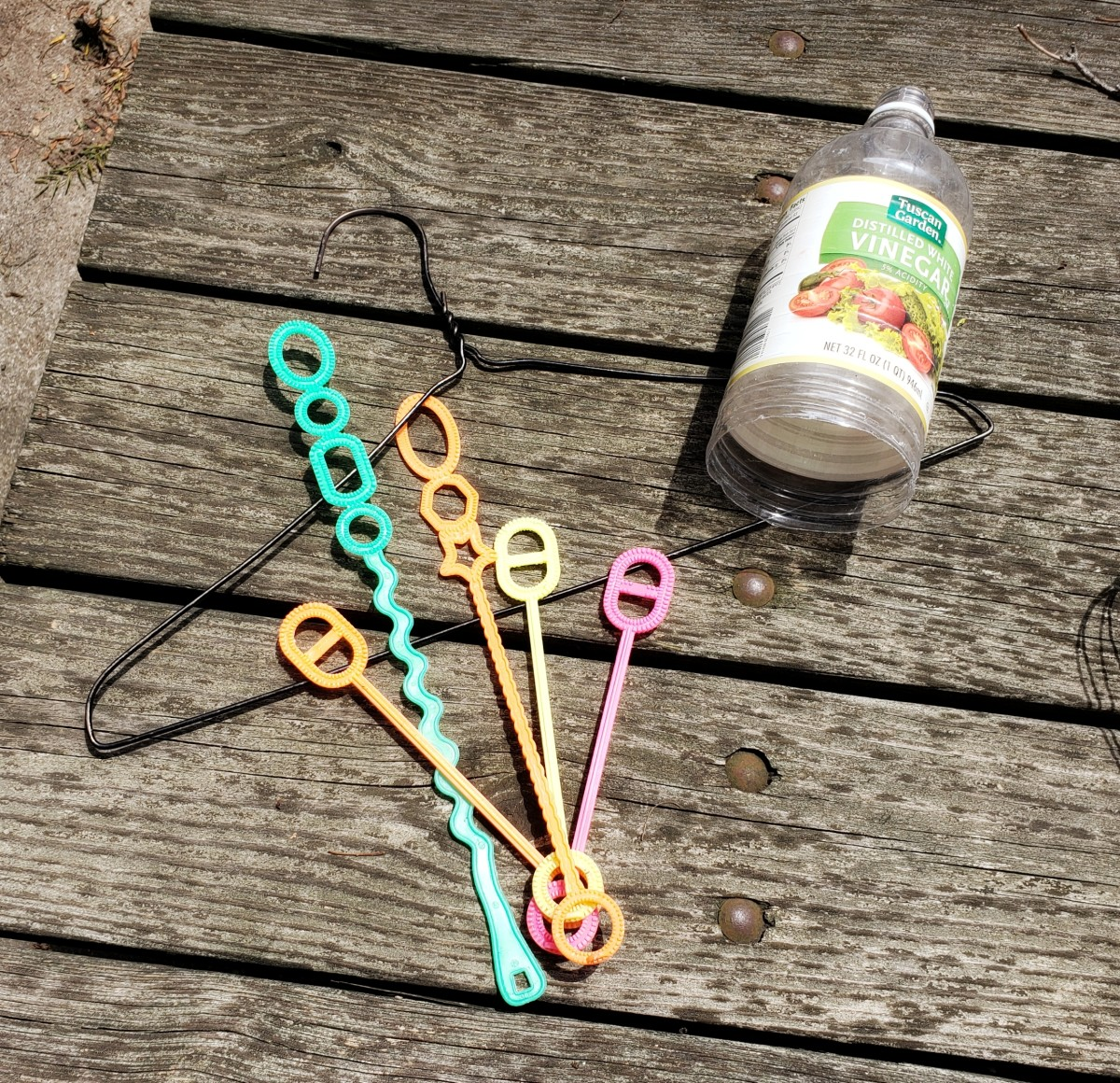 Get creative and experiment with different materials for wands. An old plastic bottle will make large circular bubbles. Try a wire coat hanger for a challenge!