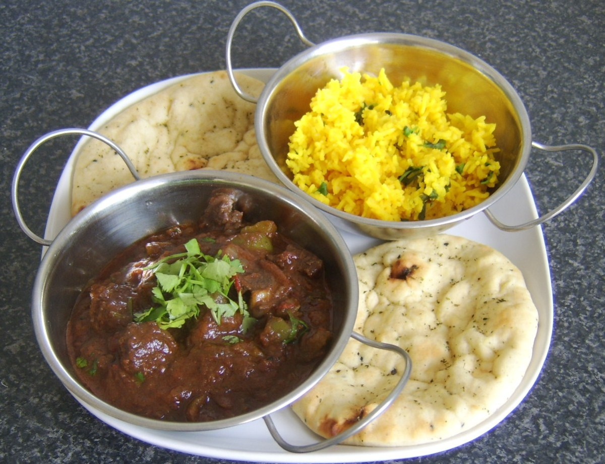 Mutton curry with fragrant rice. Coriander/cilantro is a very popular item used in Indian cuisines.