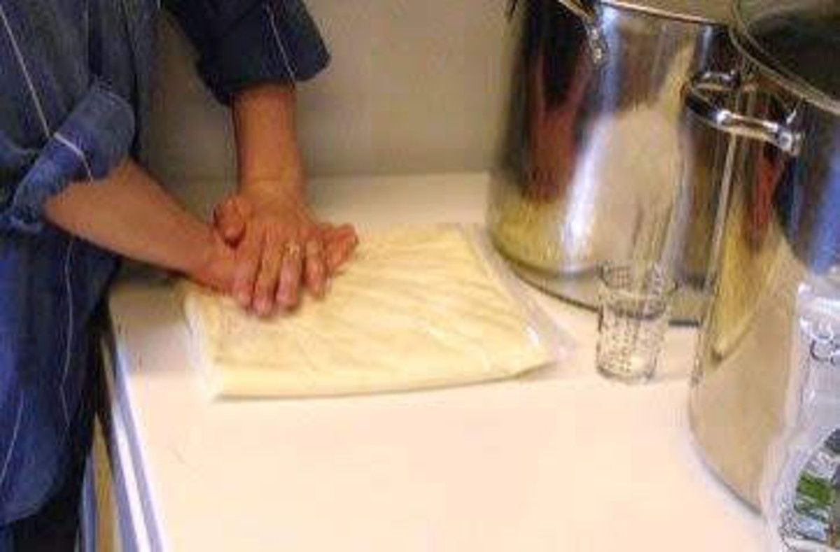 Squishing the air out of the bag, and smoothing the cheese.