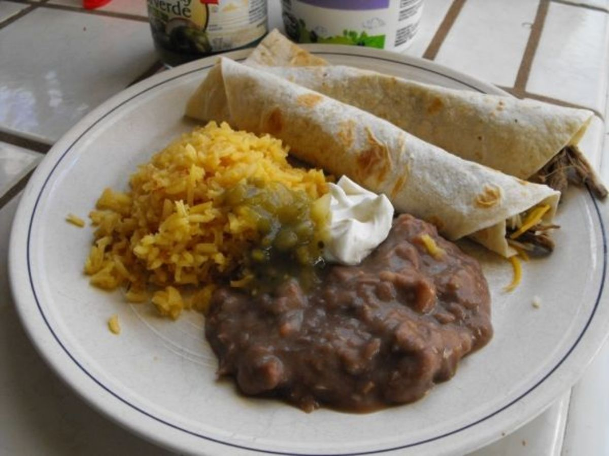 Mexican rice and beans served with tacos.