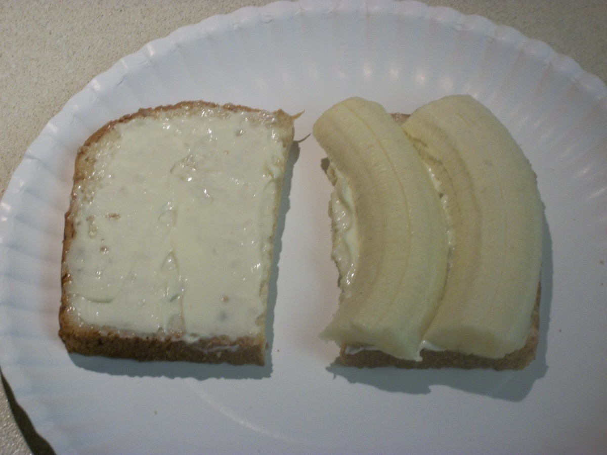 Banana sandwich on Oroweat Oatnut bread, slathered with Duke's mayo