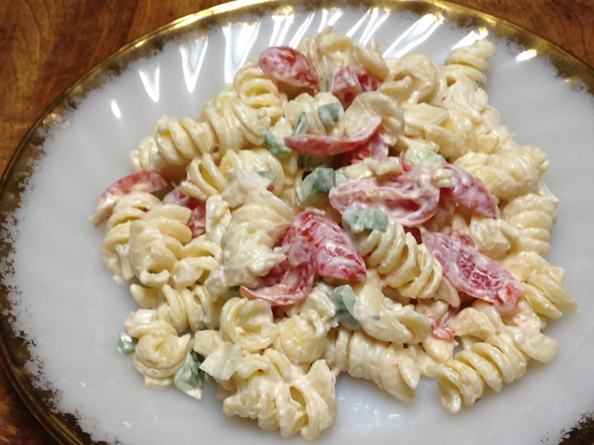 Pasta salad with Dukes mayo, sweet onions, tomatoes, and cucumbers