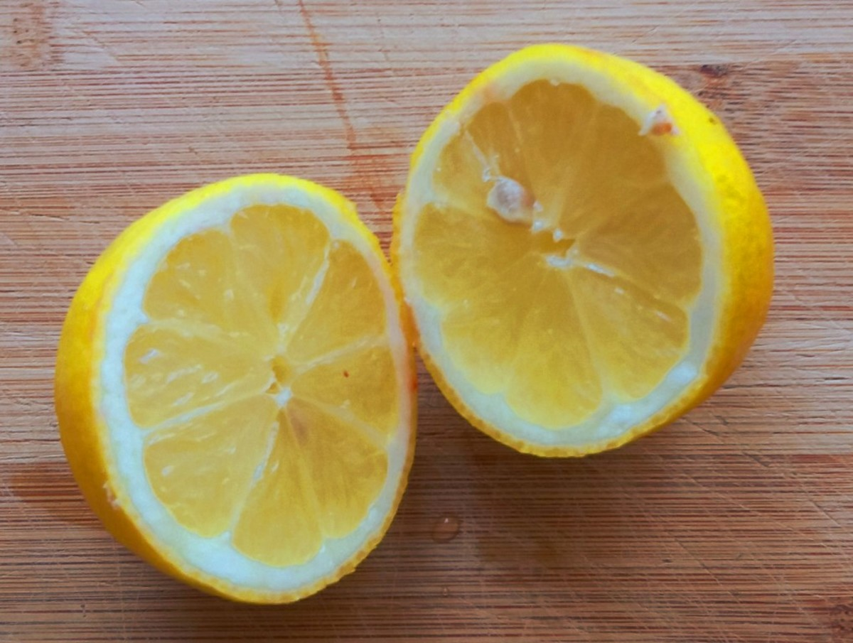 Chop a lemon in half and squeeze out the juice