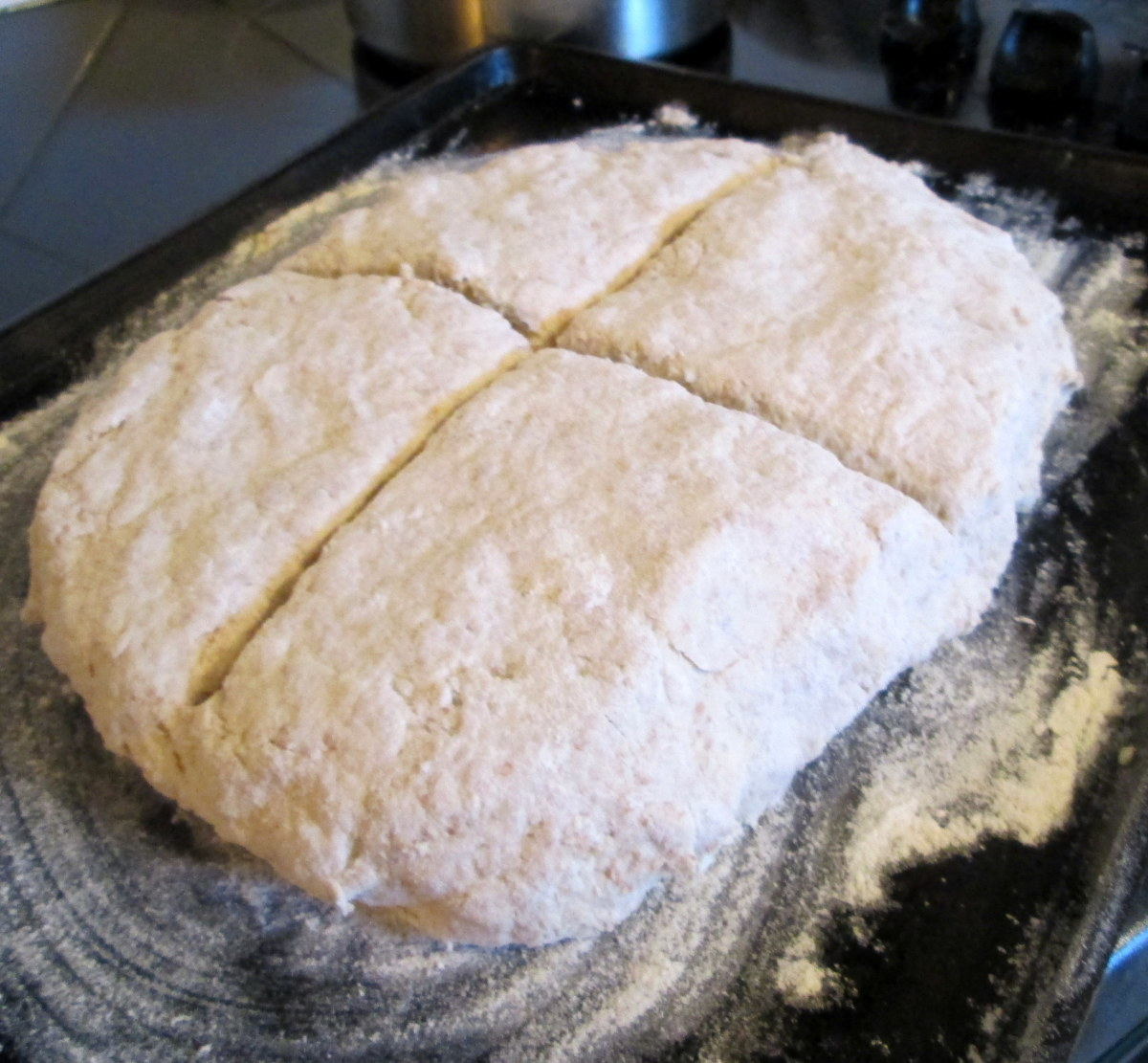Make the cross: Using a large knife, cut down and across to make a deep cut in the dough.
