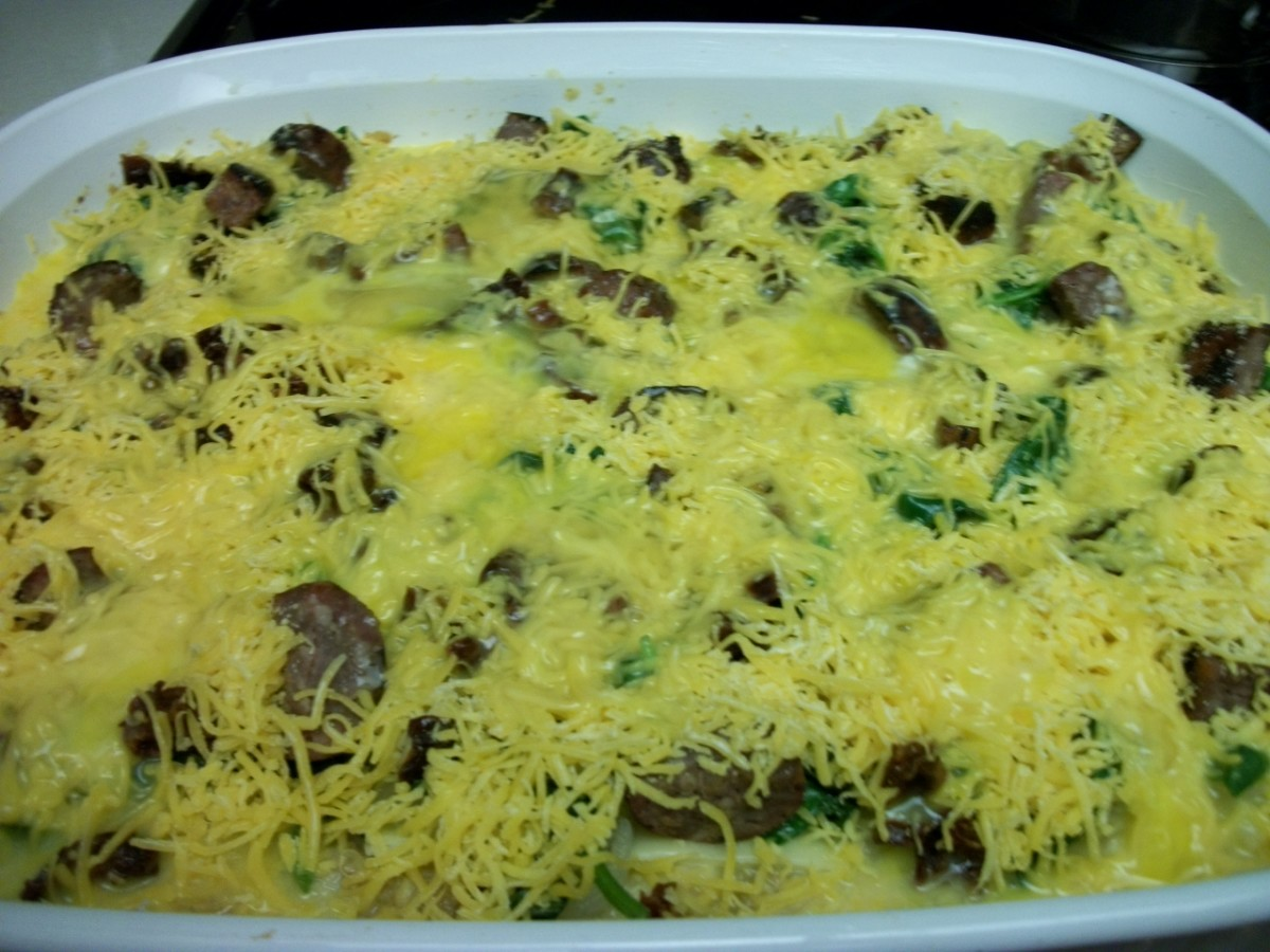 Strata topped with shredded cheese and additional beaten eggs