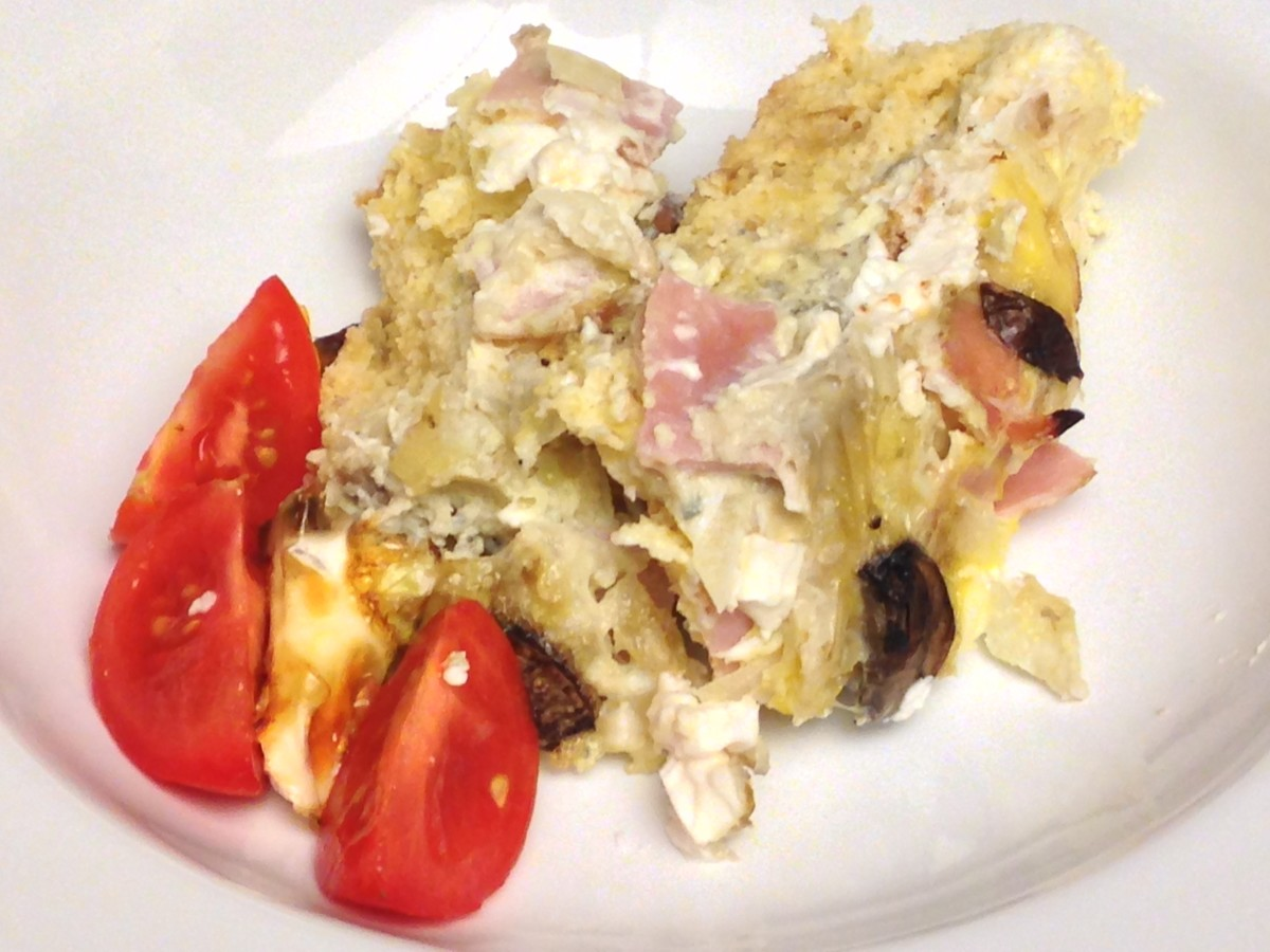 Strata made with onion rolls, gorgonzola cheese, cream cheese, mushrooms, onions, and ham