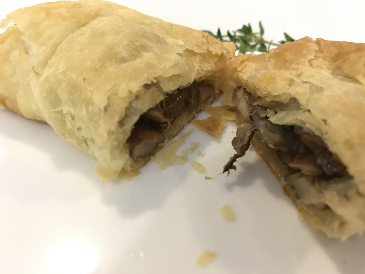 Layers of golden, flaky pastry and silky, earthy mushroom filling.