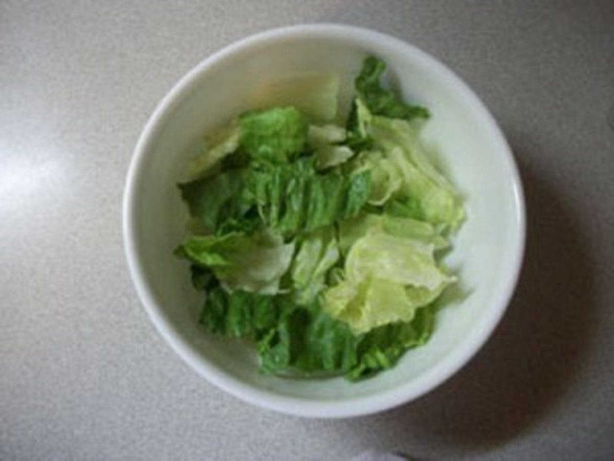 Add lettuce to bowl.