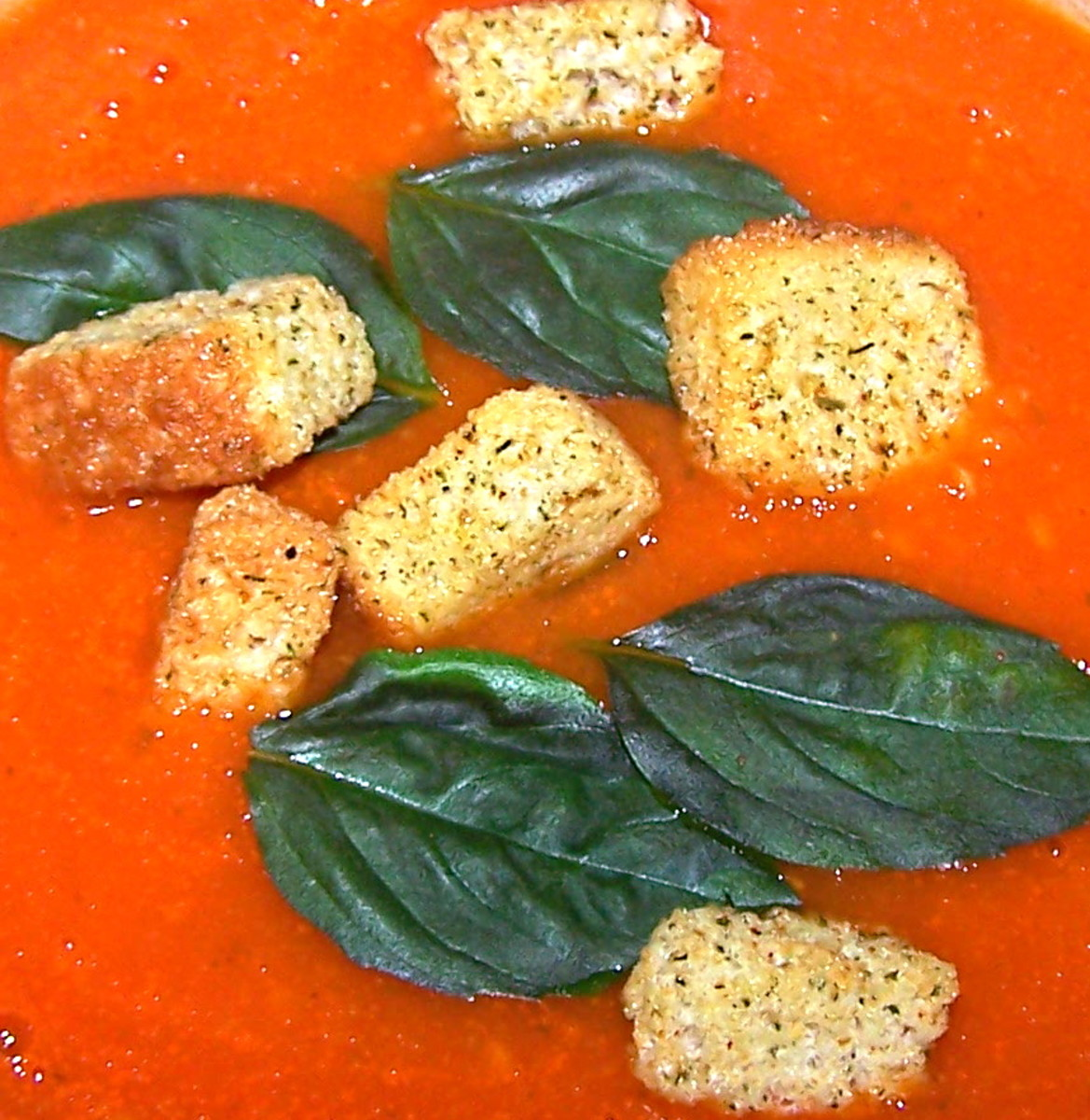 Step six: Make and add the crunchy croutons and top with fresh basil leaves.