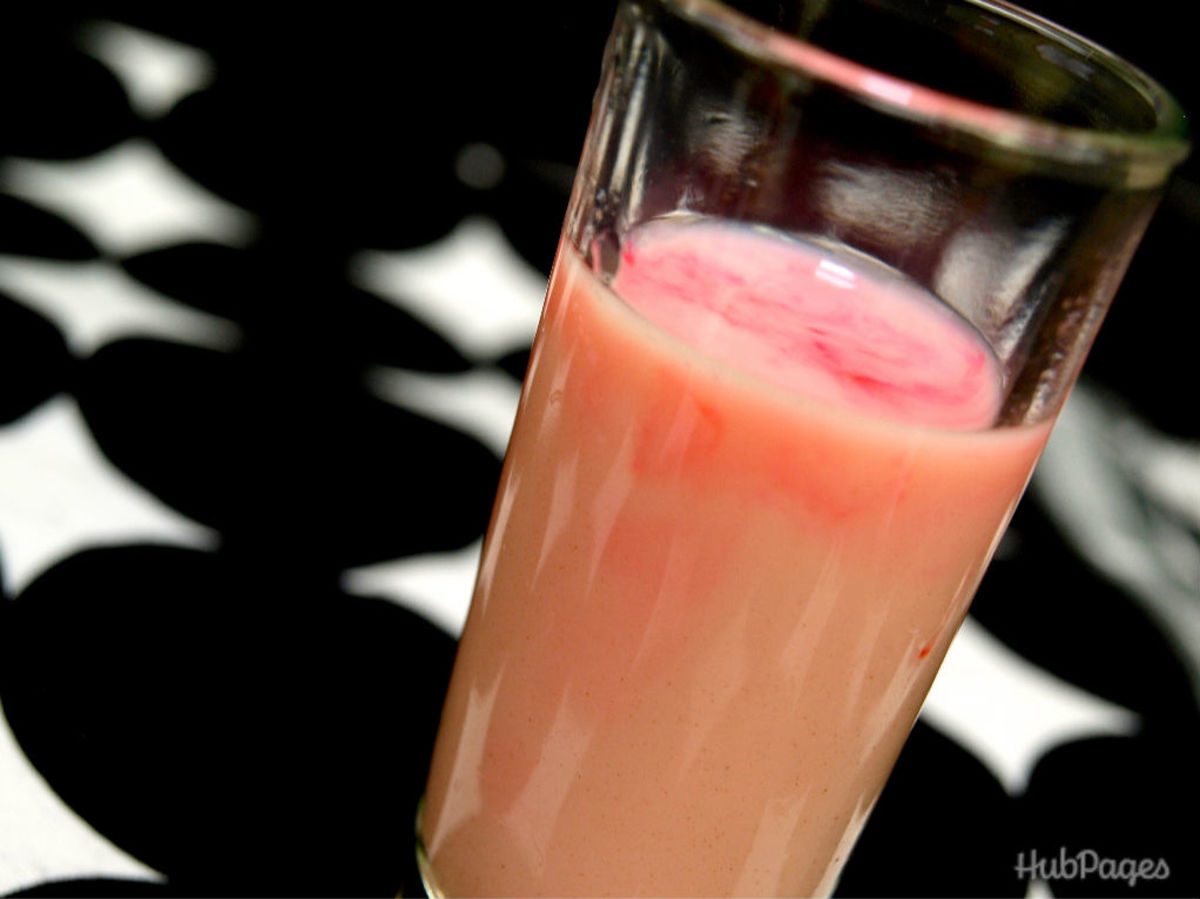 A cocktail of Hemorrhaging Brain, with strawberry liquor, irish cream, and grenadine, is haunting but tasty.
