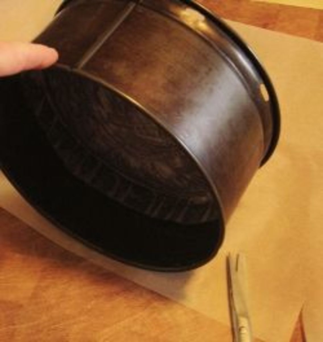 Measuring the paper for the sides of the cake tin.