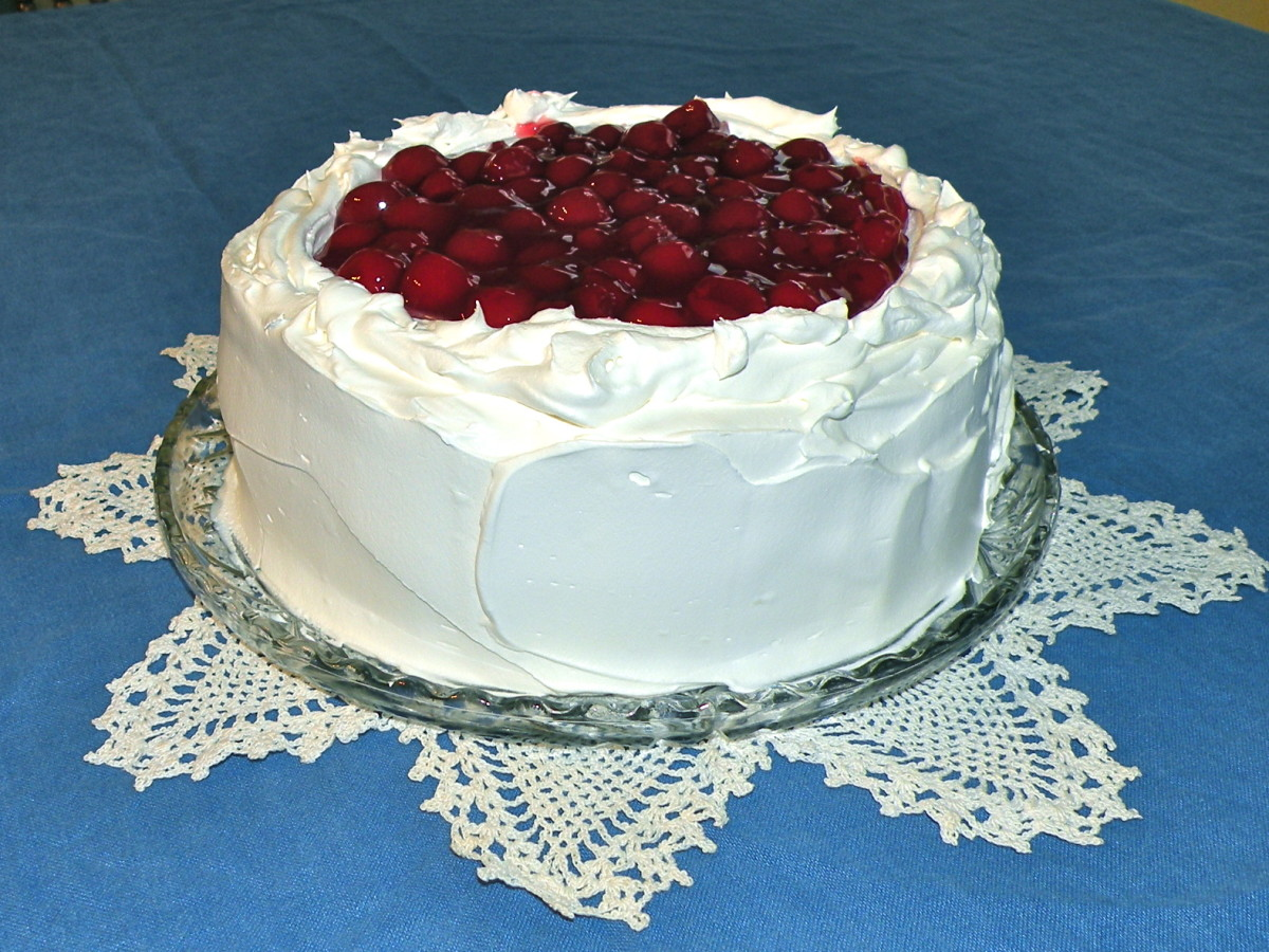 "Shown is the Easy Black Forest Cake made in 9""  round layers. Make the larger 9"" X 13"" version for a crowd."