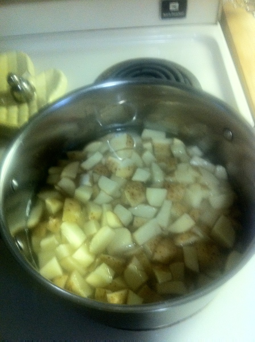 Cooking the cubed potatoes.