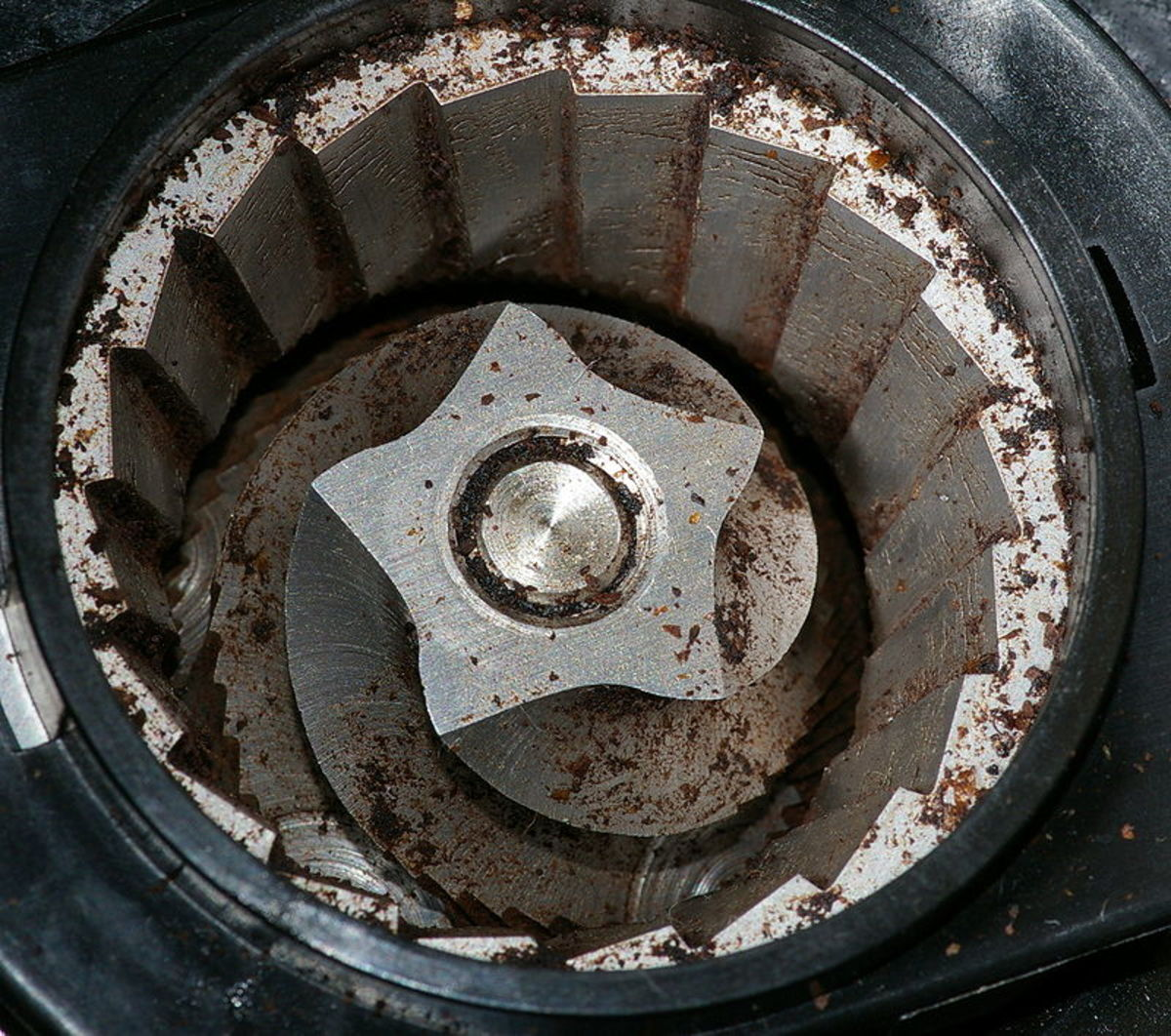 A burr grinder interior.  The bean hopper, which sits on top, has been removed in order to see inside.  The coffee beans are crushed and torn, rather than chopped, meaning that very little heat is generated.