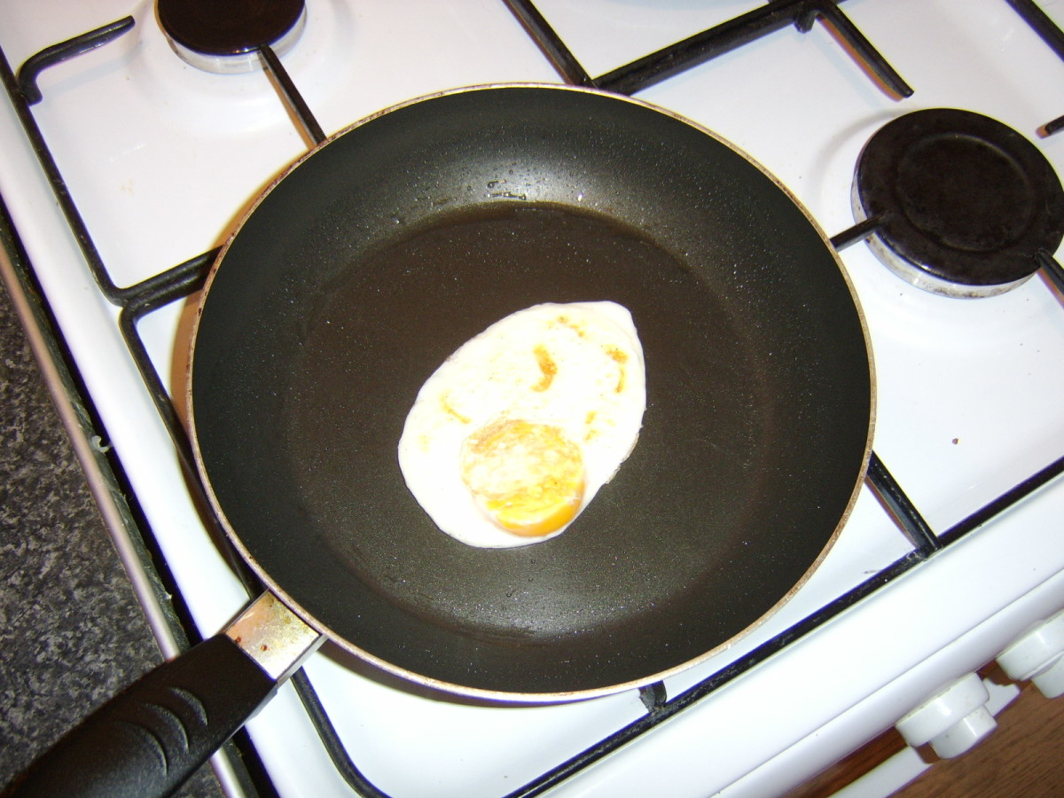The egg is fried for a couple of minutes on the second side.